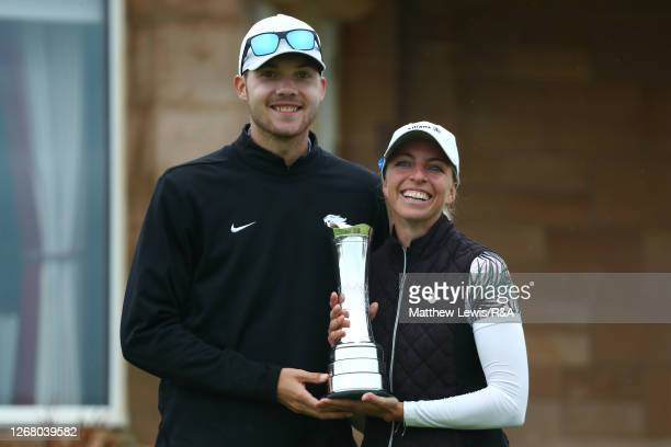 SophiaPopov of Germany and boyfriend/caddie Maximilian Mehles pose with the trophy following the final round during Day Four of the 2020 AIG Women's...