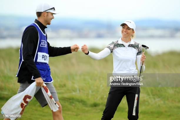 SophiaPopov of Germany and caddie Maximilian Mehles fist bump after a birdie on the 2nd hole during Day Four of the 2020 AIG Women's Open at Royal...