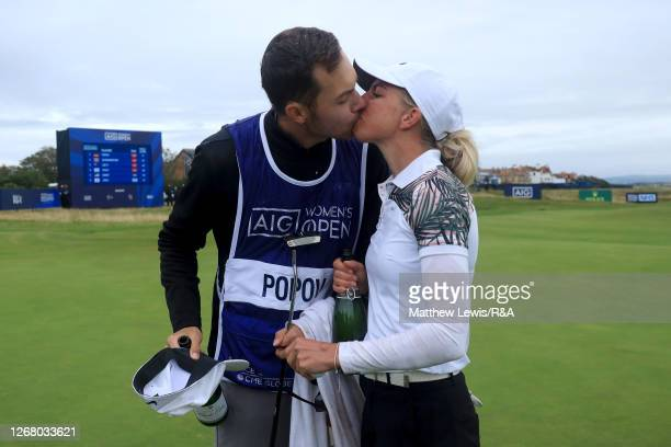 SophiaPopov of Germany celebrates victory with caddie Maximilian Mehles on the 18th green during Day Four of the 2020 AIG Women's Open at Royal...