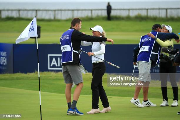 SophiaPopov of Germany celebrates victory with her caddie Maximilian Mehles on the 18th green during Day Four of the 2020 AIG Women's Open at Royal...