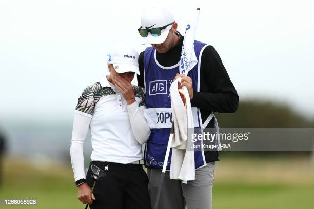 SophiaPopov of Germany is embraced by her boyfriend and caddie Maximilian Mehles on the 18th green during Day Four of the 2020 AIG Women's Open at...