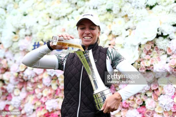 SophiaPopov of Germany pours a drink into the trophy following victory in the final round on Day Four of the 2020 AIG Women's Open at Royal Troon on...