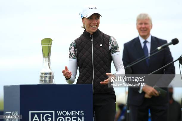 SophiaPopov of Germany walks to collect the trophy following the final round during Day Four of the 2020 AIG Women's Open at Royal Troon on August...