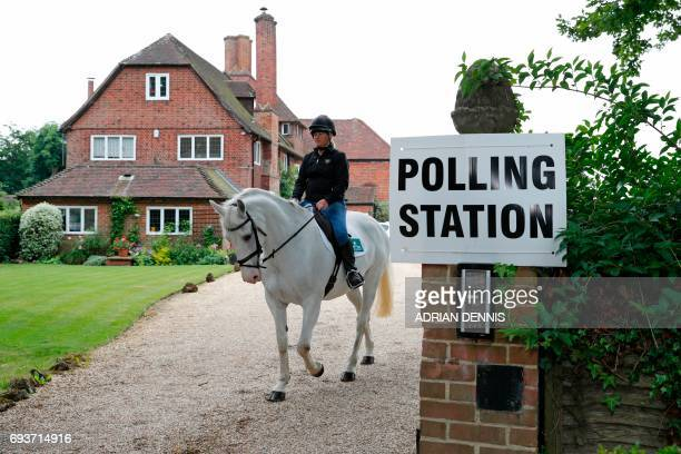 TOPSHOT Sophie Allison riding her horse Splash rides out of the driveway of a private residence set up as a Polling Station near Reading west of...