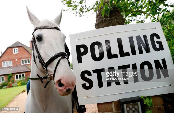 Sophie Allison riding her horse Splash rides out of the driveway of a private residence set up as a Polling Station near Reading west of London on...