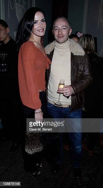 Sophie Anderton and Scott Henshall attend the Umberto Giannini Glam Hair Catwalk Show at Home House on October 20 2010 in London England