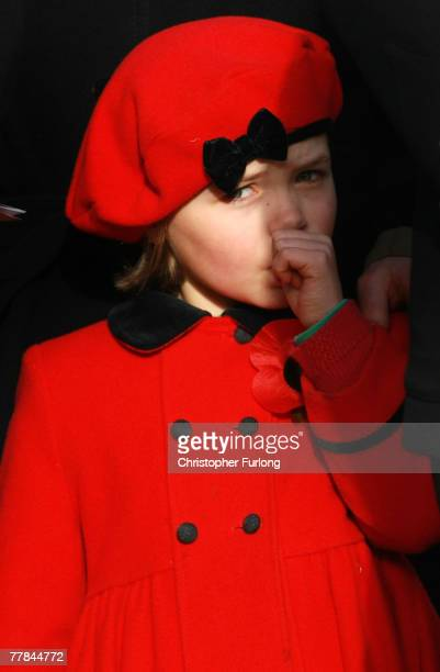 Sophie Bagot Jewitt age 6 daughter of Lord Bagot sucks her thumb as the first Remembrance Day service takes place at the Armed Forces Memorial at The...