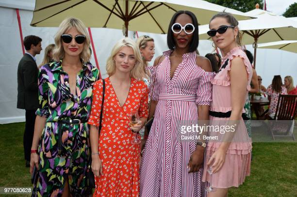 Sophie Ball guest Vanessa Kingori and Frankie Herbert attend the Cartier Queen's Cup Polo Final at Guards Polo Club on June 17 2018 in Egham England