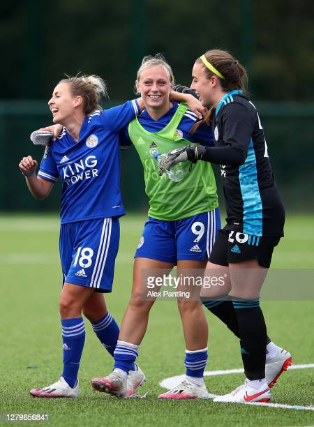 Sophie Barker, Libby Smith and Kirstie Levell of Leicester City celebrate victory during the Barclays FA Women's Championship match between Leicester...
