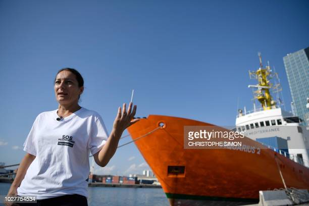 Sophie Beau SOS Mediterranee chief executive speaks to the Agence FrancePresse in front of the Aquarius rescue ship in the port of Marseille on...