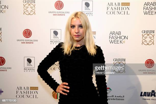 Sophie Beem poses after performing at the Arab Fashion Week Ready Couture Resort 2018 Gala Dinner on May 202017 at Armani Hotel in Dubai United Arab...