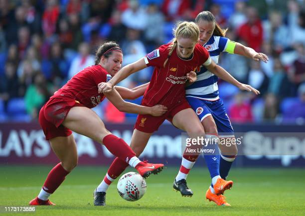 Sophie BradleyAuckland and Leighanne Robe of Liverpool tackle Natasha Harding of Reading during the Barclays FA Women's Super League match between...