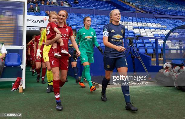 Sophie BradleyAuckland of Liverpool FC Women and Alex Greenwood of Manchester United Women lead their teams on to the pitch at the start of the...