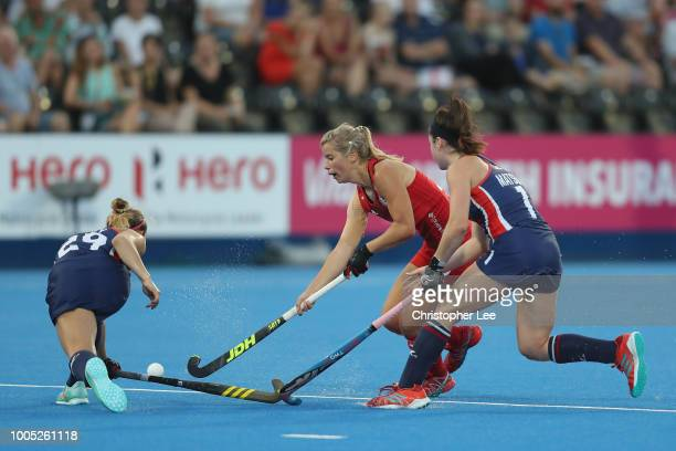Sophie Bray of England battles with Alyssa Manley of USA and Erin Matson of USA during the Pool B game between USA and England of the FIH Womens...