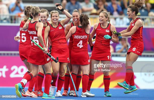 Sophie Bray of England celebrates with her teammates after scoring a goal during the Women's Bronze Medal match between England and India during...