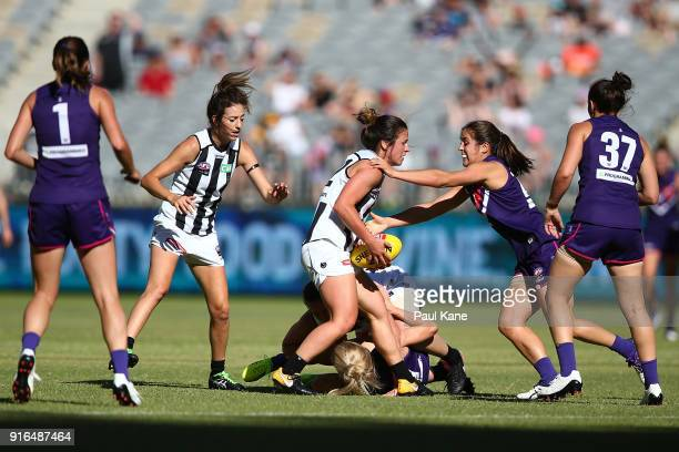Sophie Casey of the Magpies gets tackled by Gabby O'Sullivan of the Dockers during the round two AFLW match between the Fremantle Dockers and the...