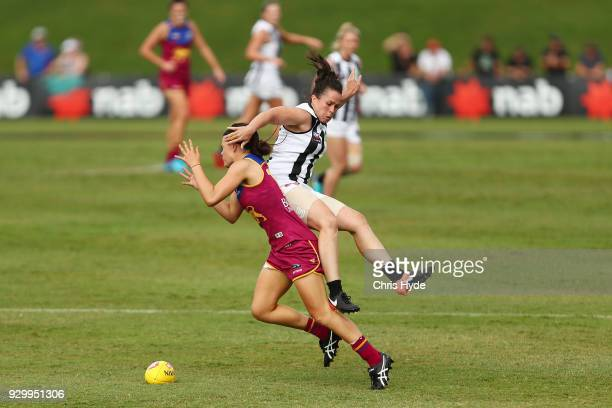 Sophie Conway of the Lions and Tara Morgan of the Magpies compete for the ball during the round six AFLW match between the Brisbane Lions and the...