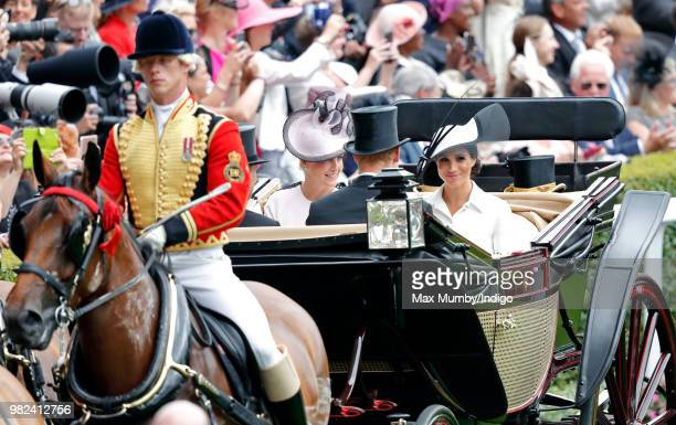 Sophie Countess of Wessex and Meghan Duchess of Sussex arrive by horse drawn carriage on day 1 of Royal Ascot at Ascot Racecourse on June 19 2018 in...