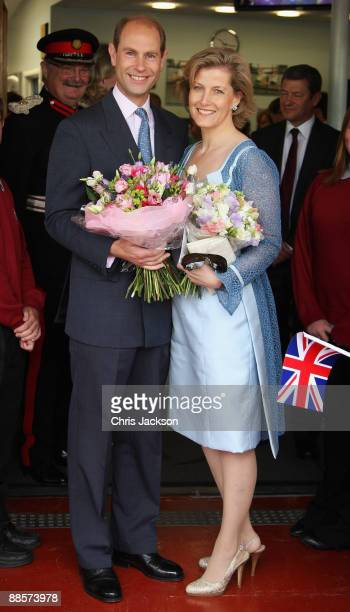 Sophie Countess of Wessex and Prince Edward Earl of Wessex pose for a photograph following a visit to Whitton School on June 19 2009 in Whitton...