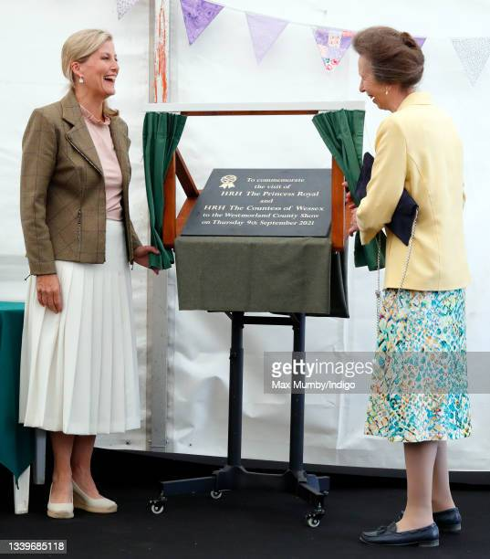 Sophie, Countess of Wessex and Princess Anne, Princess Royal unveil a plaque as they visit the Westmorland County Show on September 9, 2021 in...