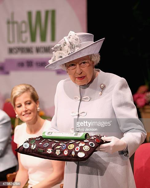 Sophie Countess of Wessex as Queen Elizabeth II presents the Centenary Women's Institute 'baton' at the Centenary Annual Meeting of The National...