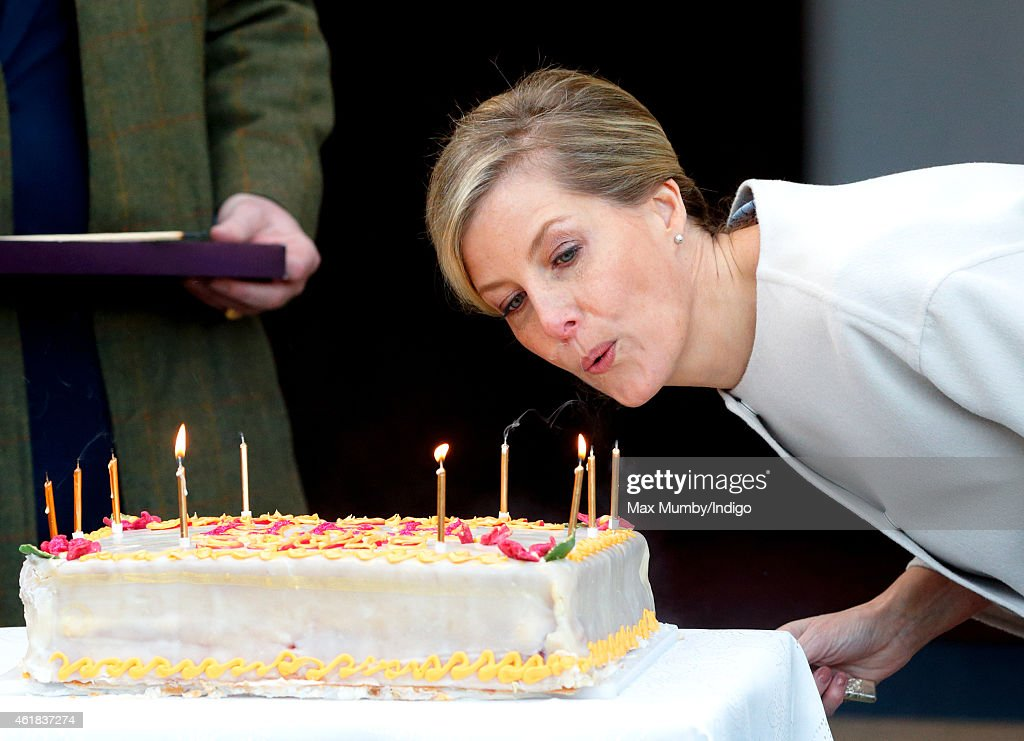 Sophie, Countess of Wessex blows out the candles on her birthday cake as she and Prince Edward, Earl of Wessex visit the Tomorrow's People Social Enterprises at St Anselm's Church, Kennington on her 50th birthday on January 20, 2015 in London, England.