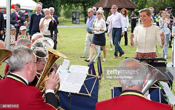 Sophie Countess of Wessex conducts the Cobham Band as she visits the Riverhill Regeneration Project on July 9 2014 in Cobham England