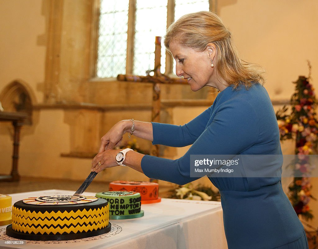 Sophie, Countess of Wessex cuts a cake during a visit to the Abbey Church of St Peter and St Paul (Dorchester Abbey) as she and Prince Edward, Earl of Wessex undertake a day of engagements in Oxfordshire on April 25, 2014 in Dorchester-on-Thames, England.