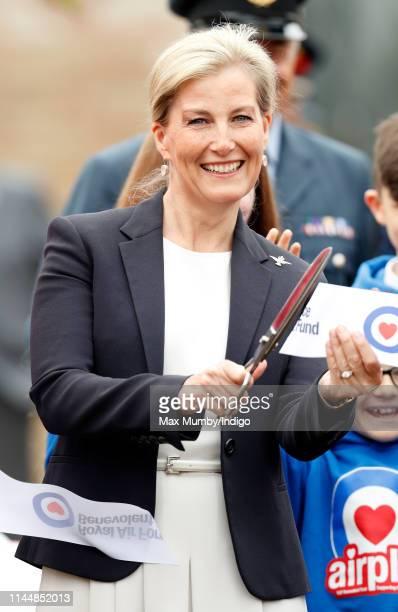 Sophie, Countess of Wessex cuts a ribbon as she opens the new Centenary Play Park during a visit to RAF Wittering on April 24, 2019 in Peterborough,...