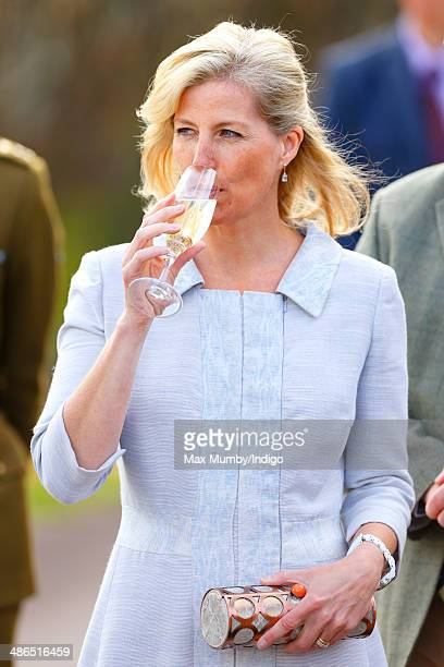 Sophie Countess of Wessex drinks a glass of English sparkling wine as she and Prince Edward Earl of Wessex visit the Three Choirs Vineyards on April...
