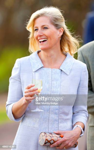 Sophie Countess of Wessex holds a glass of English sparkling wine as she and Prince Edward Earl of Wessex visit the Three Choirs Vineyards on April...