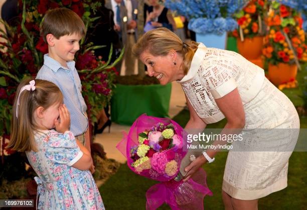 Sophie Countess of Wessex is presented with a posy of flowers as she attends a reception for the Guildford Flower Festival at Guildford Cathedral...