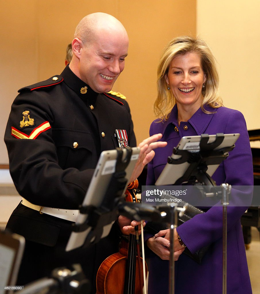 Sophie, Countess of Wessex (in her role as Colonel-in-Chief, Corps of Army Music) is shown how musicians use iPads rather than sheet music during a visit to The Countess of Wessex's String Orchestra at The Royal Artillery Barracks, Woolwich on December 8, 2014 in London, England.