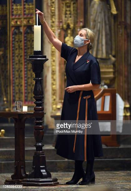 Sophie, Countess of Wessex lights a candle of remembrance as she attends the Sung Eucharist for All Souls' Day service at Westminster Abbey on...