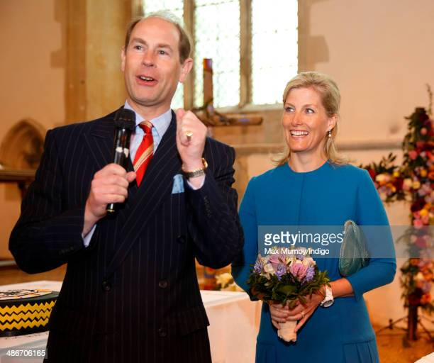Sophie, Countess of Wessex looks on as Prince Edward, Earl of Wessex makes a speech during a visit to the Abbey Church of St Peter and St Paul on a...