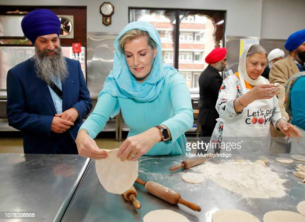Sophie, Countess of Wessex makes chapati as she visits the Sri Guru Singh Sabha Southall Gurdwara to celebrate the Gurdwara's new licensing to offer...