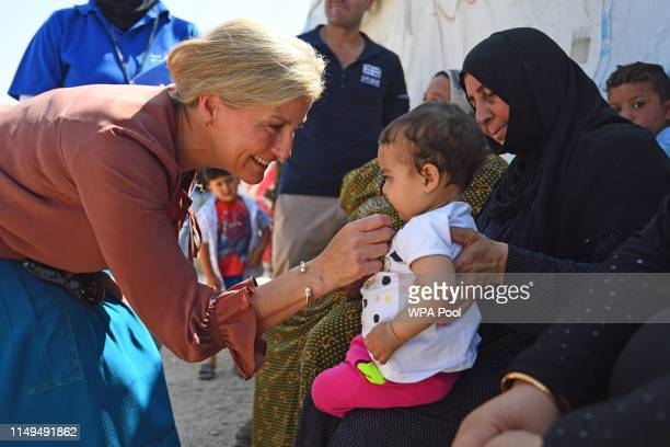 Sophie, Countess of Wessex meets a Syrian woman and child, amongst refugees displaced to Lebanon by the Syrian conflict, on a visit to an informal...