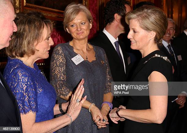 Sophie Countess of Wessex meets television presenters Alice Beer and Dame Esther Rantzen during a reception to celebrate the patronages affiliations...