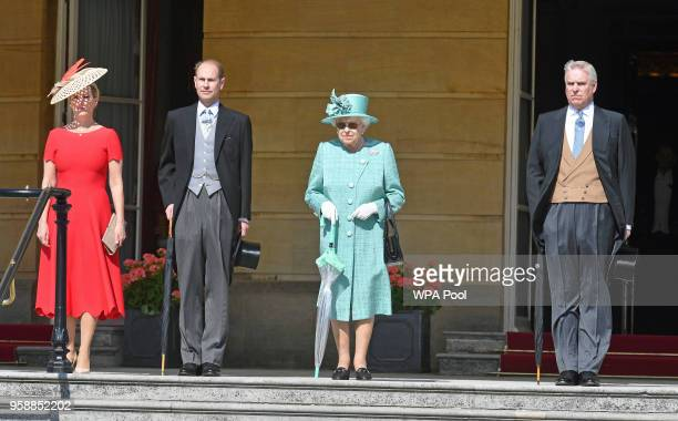 Sophie Countess of Wessex Prince Edward Earl of Wessex Queen Elizabeth II and Prince Andrew Duke of York arrive for a garden party at Buckingham...