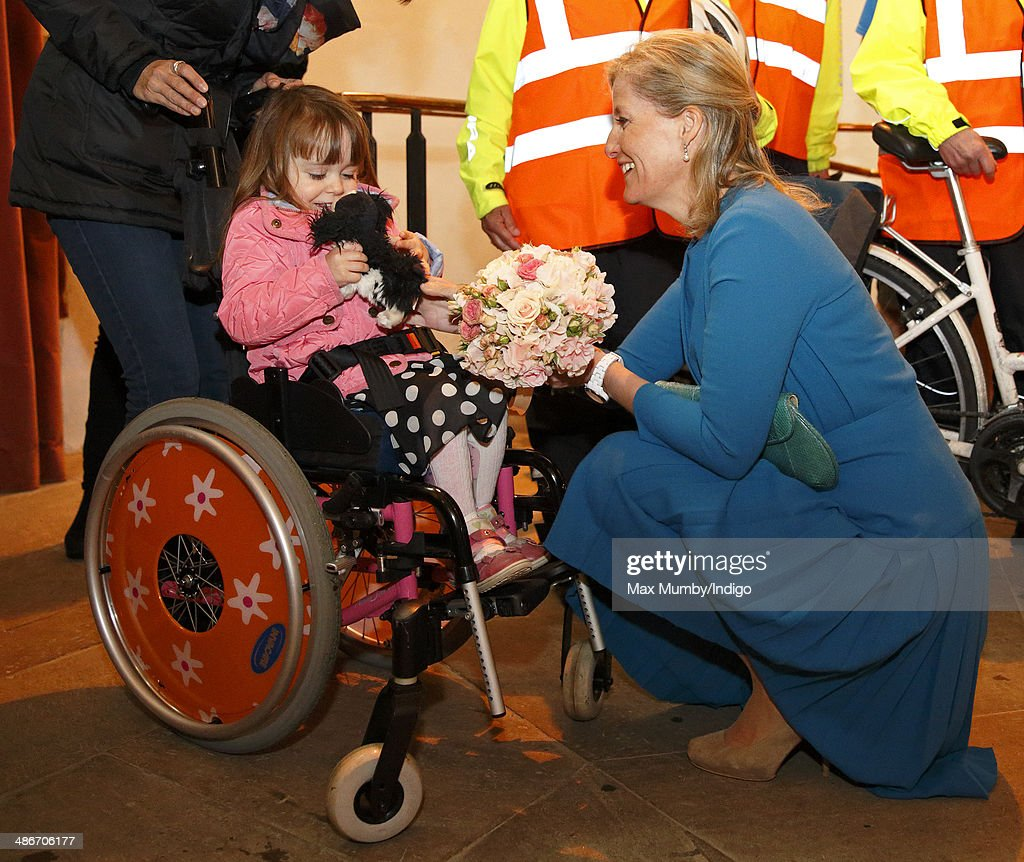 Sophie, Countess of Wessex receives a posy of flowers from Sophia Aitken during a visit to the Abbey Church of St Peter and St Paul (Dorchester Abbey) as she and Prince Edward, Earl of Wessex undertake a day of engagements in Oxfordshire on April 25, 2014 in Dorchester-on-Thames, England.