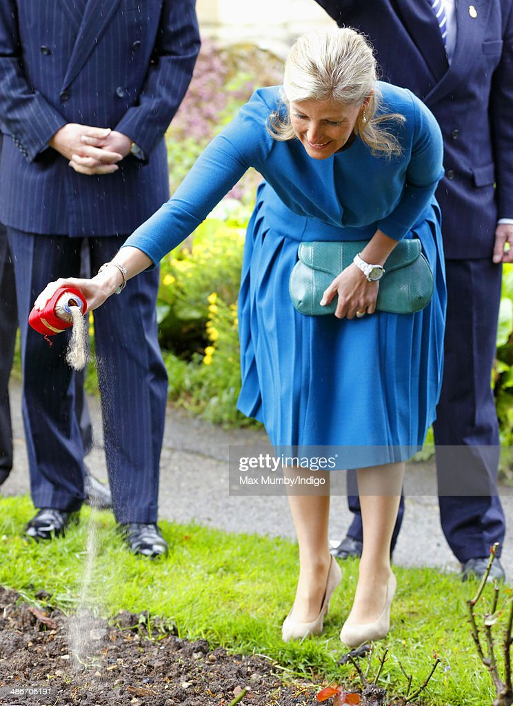 Sophie, Countess of Wessex scatters poppy seeds in the grounds of the Abbey Church of St Peter and St Paul (Dorchester Abbey) as she and Prince Edward, Earl of Wessex undertake a day of engagements in Oxfordshire on April 25, 2014 in Dorchester-on-Thames, England.