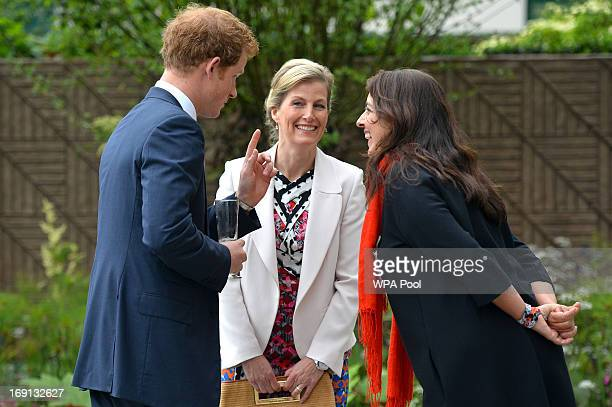 Sophie Countess of Wessex speaks with Prince Harry and garden designer Jinny Blum in the BQ Sentebale ForgetMeNot garden at the Chelsea Flower Show...