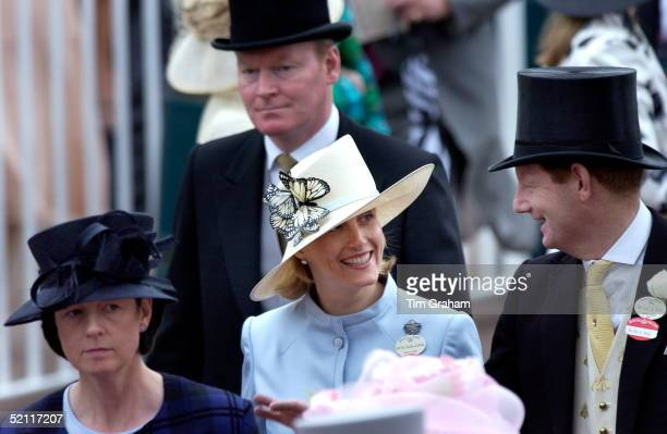 Sophie Countess Of Wessex Talking With Her Friend The Earl Of Derby The Countess Is Wearing A Pale Blue Suit And A Cream Hat Trimmed With Artificial...