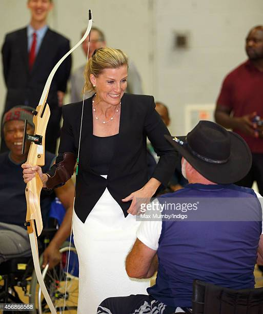 Sophie Countess of Wessex tries her hand at archery during a visit to WheelPower at the Stoke Mandeville Stadium on October 8 2014 in Aylesbury...