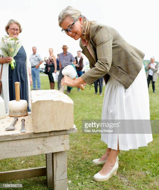 Sophie, Countess of Wessex tries her hand at stonemasonry as she visits the Westmorland County Show on September 9, 2021 in Milnthorpe, England.
