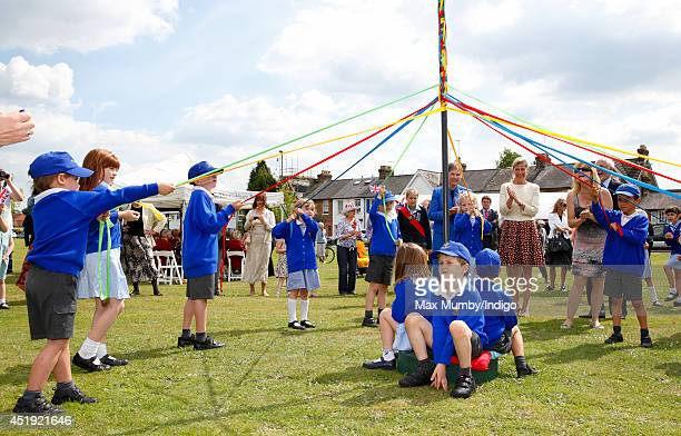 Sophie Countess of Wessex watches children maypole dancing as she visits the Riverhill Regeneration Project on July 9 2014 in Cobham England