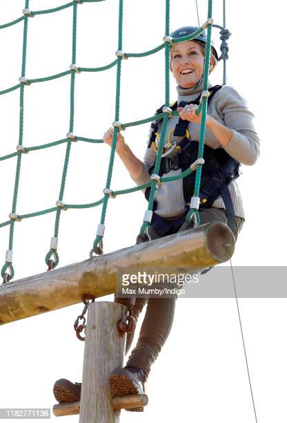Sophie, Countess of Wessex wears a climbing harness and helmet as she tries out a high-wire assault course during The Countess of Wessex Cup 2019 at...