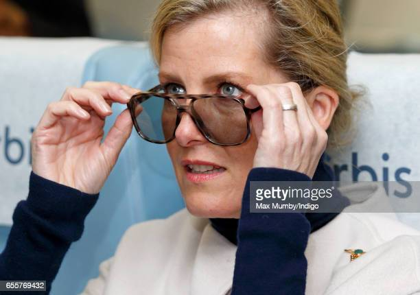 Sophie Countess of Wessex wears a pair of 3D glasses as she tours the Orbis Flying Eye Hospital at Stansted Airport on March 20 2017 in London...