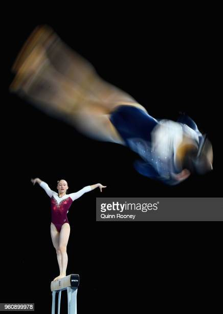 Sophie Crisante of Queensland competes on the Beam as Abigail Griffiths competes on the Floor during the 2018 Australian Gymnastics Championships at...