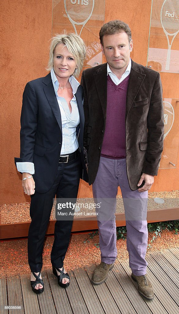 Sophie Davant and Pierre Sled arrive at 'Le Village' during the 2009 French Tennis Open at Roland Garros arena on May 28, 2009 in Paris, France.